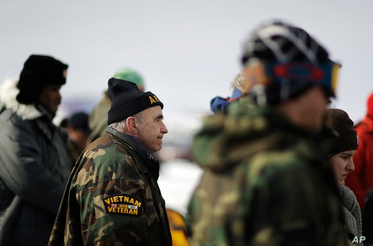 Vietnam Army veteran Dan Luker of Boston attends a briefing for fellow veterans at the Oceti Sakowin camp where people have gathered to protest the Dakota Access oil pipeline in Cannon Ball, N.D., Dec. 3, 2016.