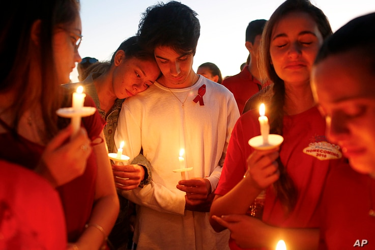 Students gather during a vigil at Pine Trails Park for the victims of the Wednesday shooting at Marjory Stoneman Douglas High School, in Parkland, Fla., Feb. 15, 2018.