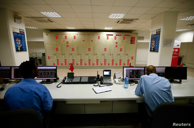 Engineers work in the control room of Gibe III hydroelectric dam in  in Ethiopia, Dec. 16, 2016.