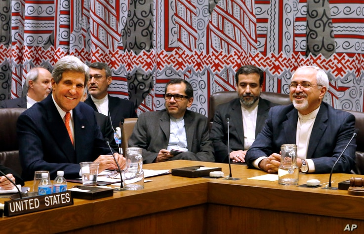 FILE - In this Sept. 26, 2013 file photo, U.S. Secretary of State John Kerry, left, and Iranian Foreign Minister Javad Zarif, right, attend a meeting of the five permanent members of the Security Council plus Germany during the 68th session of the Un...