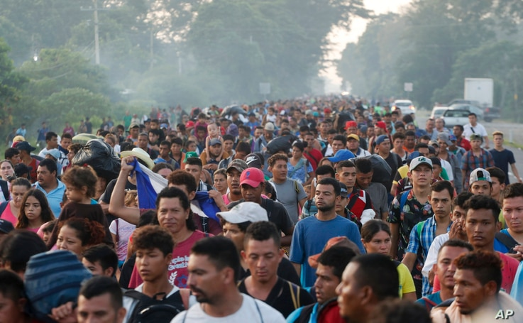 Central American migrants walking to the U.S. start their day departing Ciudad Hidalgo, Mexico, Oct. 21, 2018.