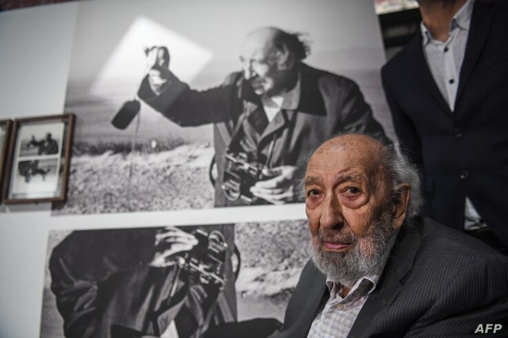 Turkish photographer Ara Guler looks on during the opening of Ara Guler museum, Aug. 16, 2018 in Istanbul. A photographer of the world, Guler was best known for his photos of his native Istanbul.