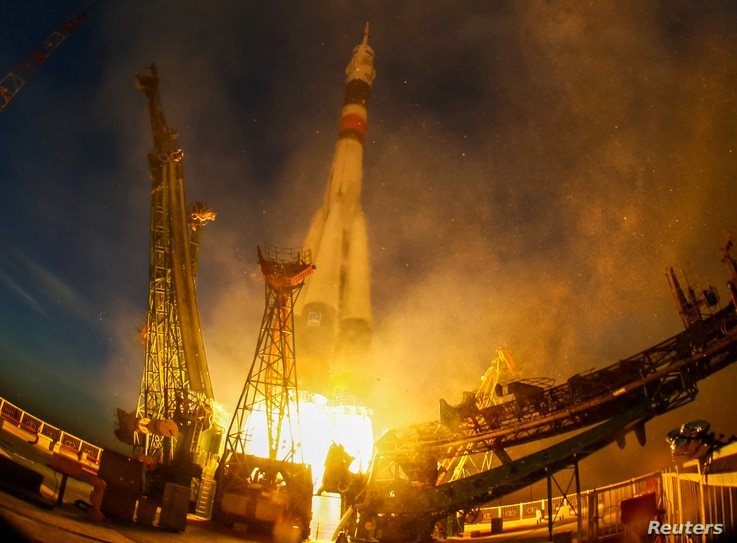 The Soyuz MS-11 spacecraft carrying the crew formed of David Saint-Jacques of Canada, Oleg Kononenko of Russia and Anne McClain of the U.S. blasts off to the International Space Station, Kazakhstan Dec. 3, 2018.