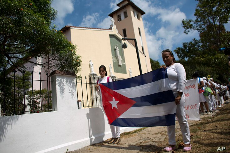 FILE - A women's dissident group that calls for the release of political prisoners marches in Havana, Cuba, March 20, 2016.
