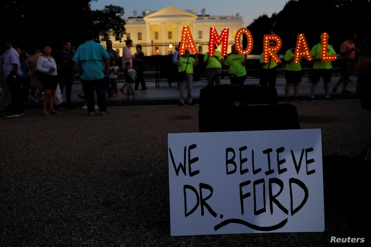 """#KremlinAnnex protesters place a sign referring to Christine Blasey Ford, the woman who accused Supreme Court nominee Judge Brett Kavanaugh of a 1982 sexual assault, and spell out the word """"AMORAL"""" on the 66th consecutive day of their demonstration o..."""
