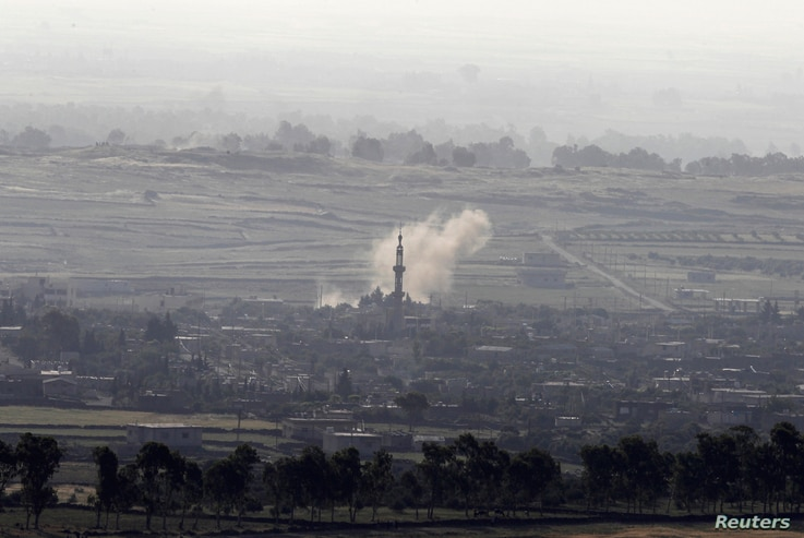 Smoke rises after shells exploded in the Syrian village of al-Rafeed, close to the cease-fire line between Israel and Syria, as seen from the Israeli occupied Golan Heights May, 7, 2013.