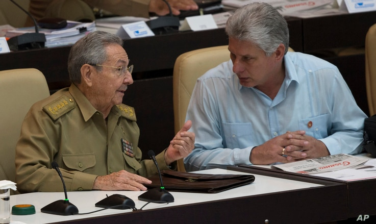 Cuba's President Raul Castro, left, talks with Vice President Miguel Diaz Canel during the opening of the National Assembly session in Havana, Cuba, Friday, July 8, 2016.