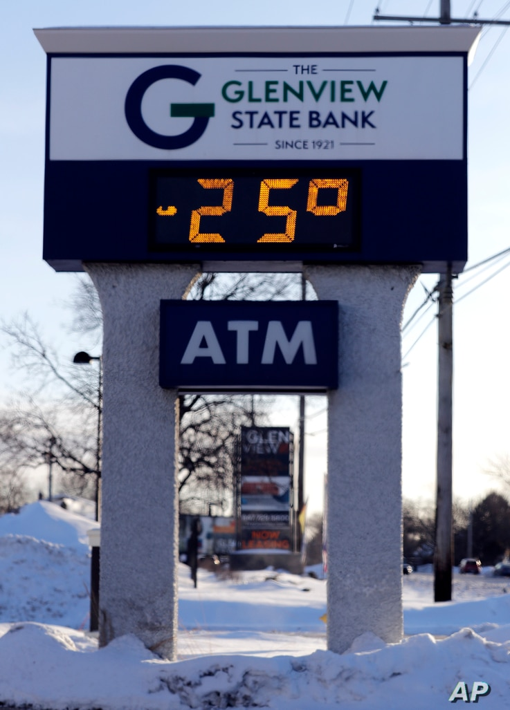 A sign shows the current outdoor temperature in Glenview, Ill., Jan. 30, 2019. A deadly arctic deep freeze enveloped the Midwest with some record-breaking temperatures on Wednesday.
