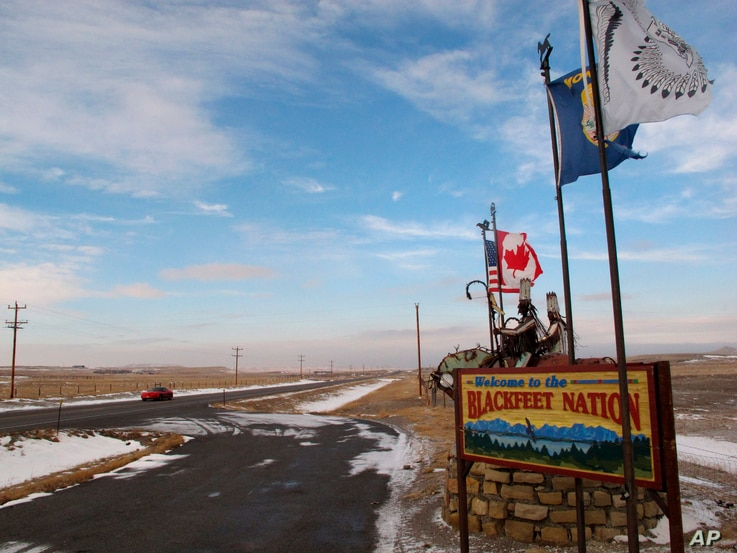 FILE - A sign welcoming visitors to the Blackfeet Indian reservation in Browning, Mont., Dec. 12, 2012. Montana might be known internationally for such recreational jewels as Glacier and Yellowstone national parks, but Native Americans say the state...