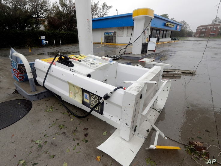A gas pump lies on there ground after strong winds in Wilmington, N.C., toppled it after Hurricane Florence made landfall Friday, Sept. 14, 2018.
