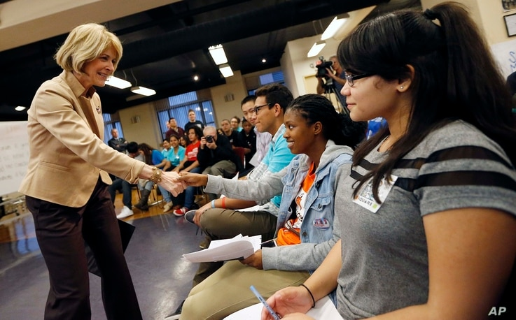 FILE - Massachusetts Democratic gubernatorial candidate Martha Coakley, left, greets participants as she arrives for a youth vote forum at the Service Employees International Union office in Boston.