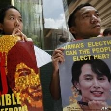 Members of the Hong Kong Coalition for a Free Burma, hold posters of detained opposition leader Aung San Suu Kyi during a demonstration in commemoration of the third anniversary of the Saffron Revolution, in Hong Kong, 27 Sep 2010.
