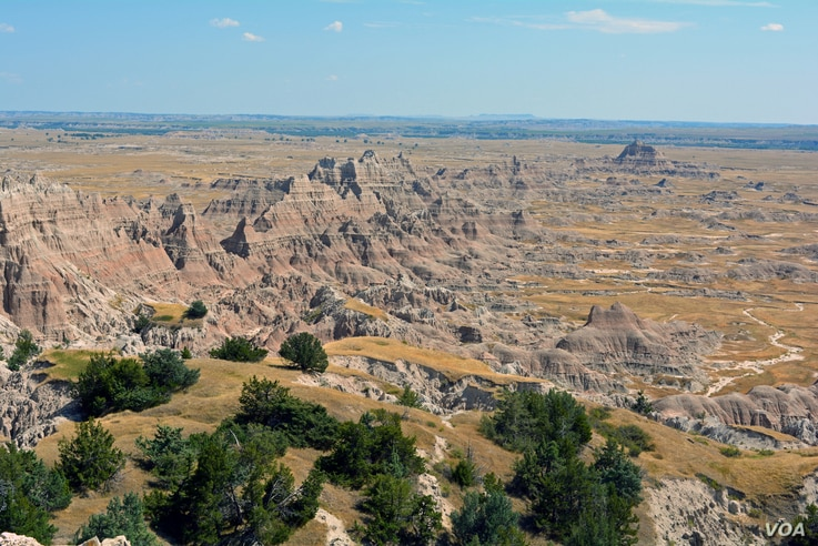 The landscape of the Badlands boasts a maze of buttes, canyons, pinnacles and spires, with sedimentary rock layers exposed by eons of erosion.