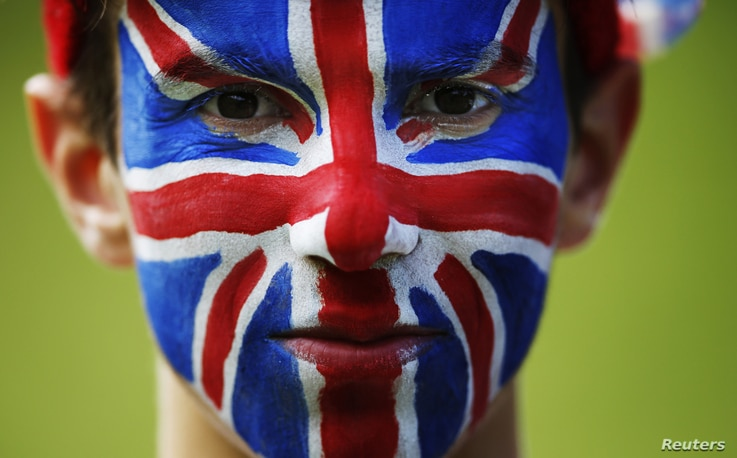 Spectator Nat Aaronson, whose face is painted like a Union flag, poses for a portrait on the Box Hill circuit of the men's cycling road race at the London 2012 Olympic Games in London July 28, 2012. 012 Olympic Games in London July 28, 2012. REUTERS/...