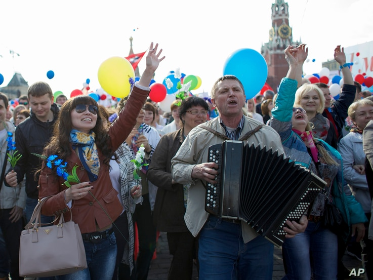 Members of Russian Trade Unions march during the May Day celebration at the Red Square in Moscow on May 1, 2014.