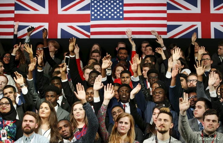 Students raise their hands to ask a question as U.S. President Barack Obama holds a town hall at the Royal Agricultural Halls in London, April 23, 2016.