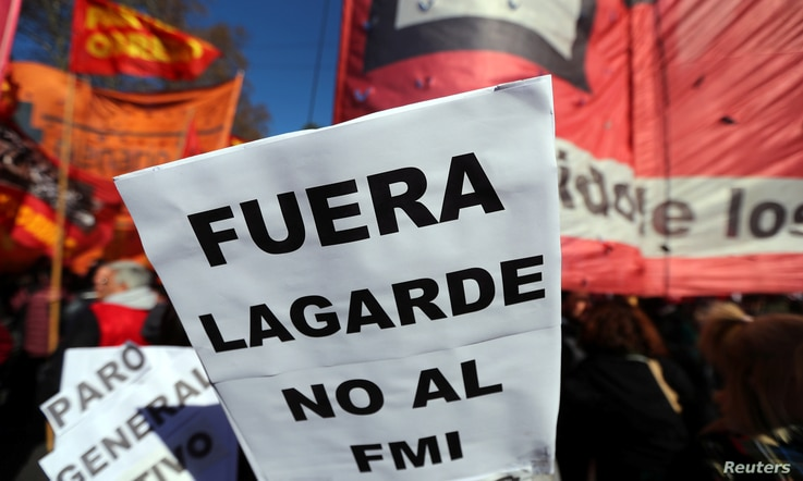 "A sign that reads ""(Christine) Lagarde, get out - No to the IMF (International Monetary Fund)"" is seen during a protest against the G-20 meeting of finance ministers in Buenos Aires, Argentina, July 21, 2018."