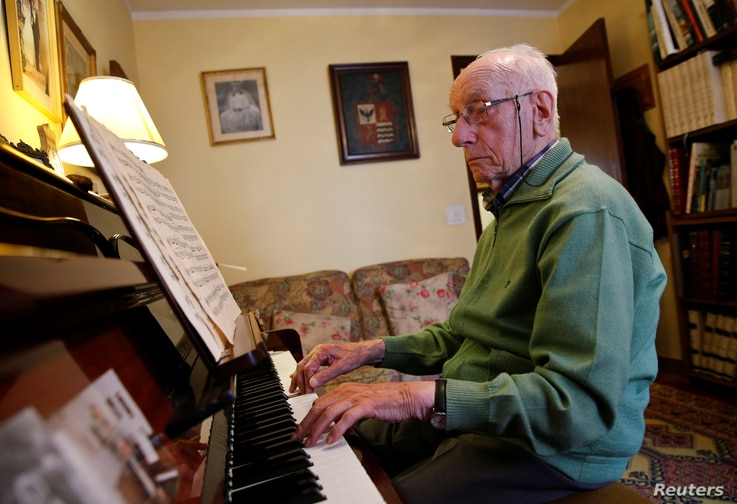 Pedro Rodriguez, 106, plays piano at his home in Cangas de Onis, Asturias, in northern Spain, July 9, 2016.