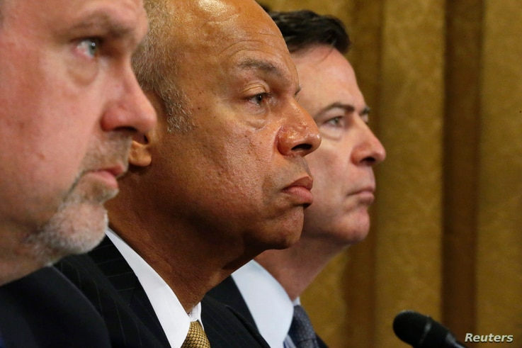 FILE - U.S. National Counterterrorism Center Director Nicholas Rasmussen, Homeland Security Secretary Jeh Johnson and FBI Director James Comey (L-R) testify before a House Homeland Security Committee hearing on Capitol Hill in Washington, July 14, 20...