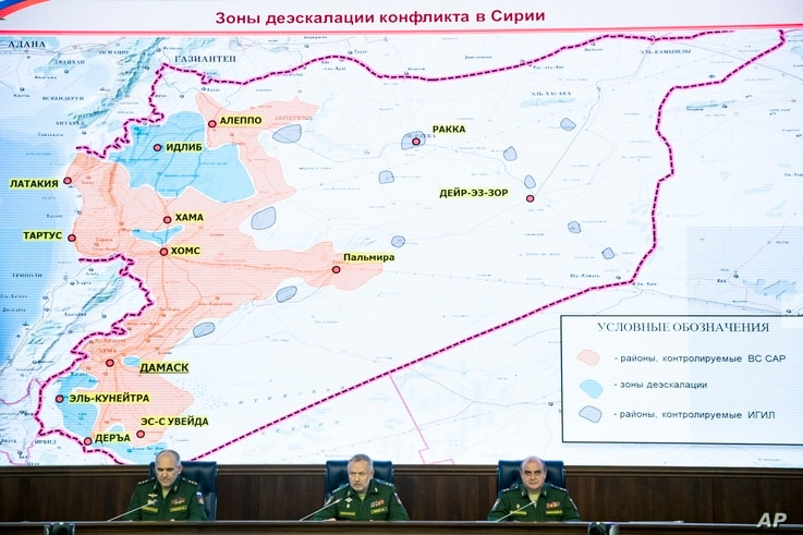 Col. Gen. Sergei Rudskoi of the Russian General Staff, (from left) Deputy Defense Minister Alexander Fomin and Lt. Gen. Stanislav Gadzhimagomedov attend a briefing in Moscow, May 5, 2017. The sign on top of the map reads Syrian safe zones.