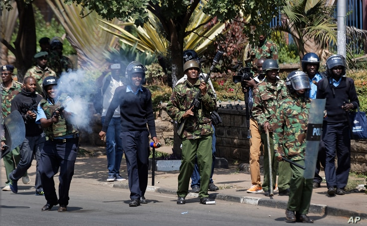 Kenyan riot police fire tear gas at opposition protesters during a rally near electoral commission offices in downtown Nairobi, Kenya, Sept. 26, 2017.