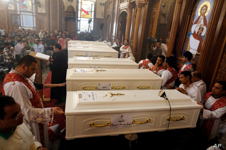 Coffins of the slain Coptic Christians are seen during their funeral service at the Church of Great Martyr Prince Tadros, in Minya, Egypt, Nov. 3, 2018.