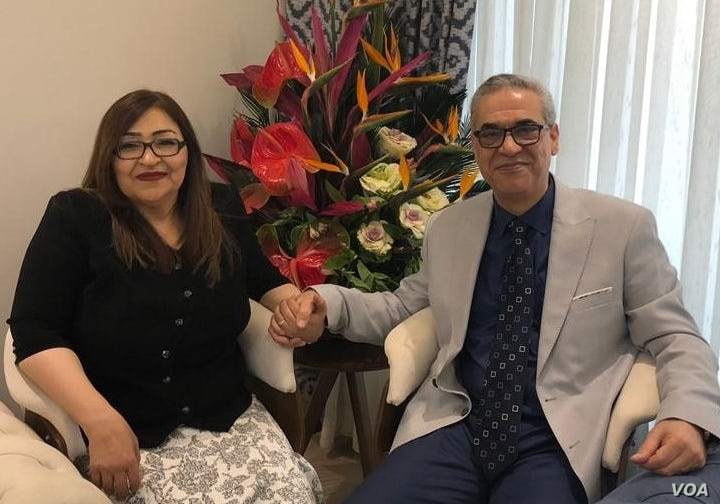 Former Iranian Baha'i community leader Afif Naeimi and his wife, Shohreh, celebrate his release from Tehran's Evin prison, Dec. 20, 2018.