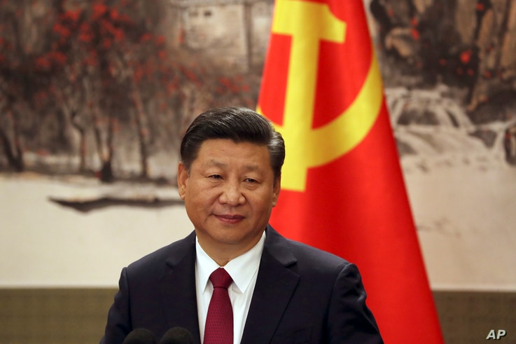 Chinese President Xi Jinping, one of the seven newly elected members of the Politburo Standing Committee, attends a press event at Beijing's Great Hall of the People on Oct. 25, 2017.