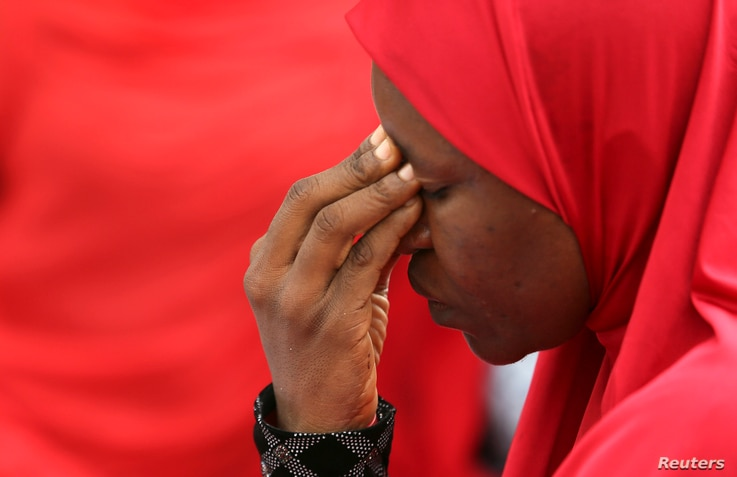 A woman takes part in a protest for the release of the abducted secondary school girls in the remote village of Chibok, during a  sit-in protest at the Unity fountain Abuja, May 12, 2014. The leader of the Nigerian Islamist rebel group Boko Haram has