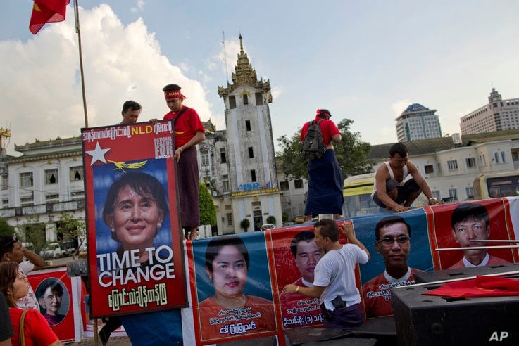 Supporters of Myanmar's opposition leader Aung San Suu Kyi's National League for Democracy party decorate the back of a truck for a campaign rally to conclude their election campaign in Yangon, Myanmar, Nov. 5, 2015.