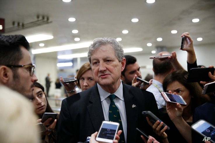FILE - Sen. John Kennedy, R-La., responds to a reporter's question on Capitol Hill, Oct. 3, 2018 in Washington.