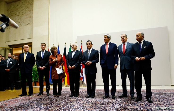 EU foreign policy chief Catherine Ashton, third from left, delivers statement during ceremony marking deal between Iran, six world powers, United Nations, Geneva, Nov. 23, 2013.