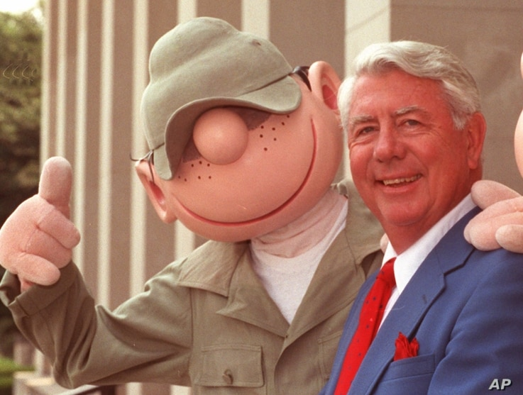 "FILE - Mort Walker, who created the comic strip ""Beetle Bailey"" in 1950, poses with an actor in ""Beetle"" costume  at the Pentagon in Washington, June 15, 1990."