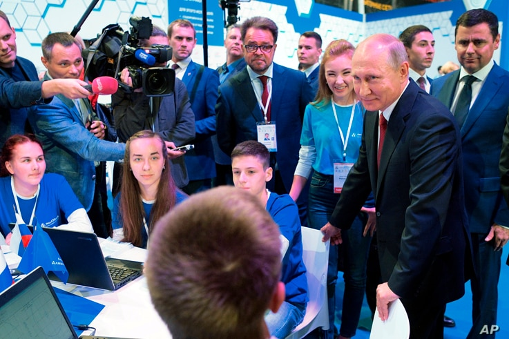"Russian President Vladimir Putin meets with students in Yaroslavl, Russia, Sept. 1, 2017.  Putin said the development of artificial intelligence raises ""colossal opportunities and threats that are difficult to predict now."""