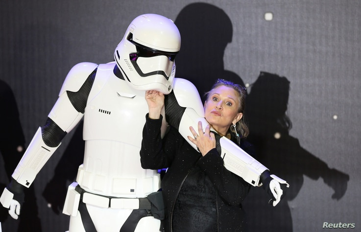 """FILE - Carrie Fisher poses for cameras as she arrives at the European Premiere of """"Star Wars, The Force Awakens"""" in Leicester Square, London, Dec. 16, 2015."""