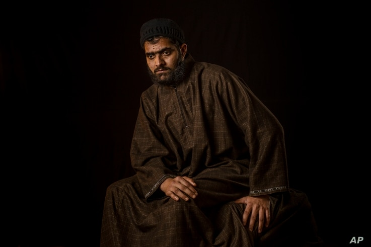 Firdous Ahmas Dar poses for a portrait in the village of Sopore, Indian-controlled Kashmir, Dec. 1, 2016. Firdous, 25, lost vision in both eyes after Indian troops used shotguns to spray hundreds of metal pellets to quell an anti-India protest in the...