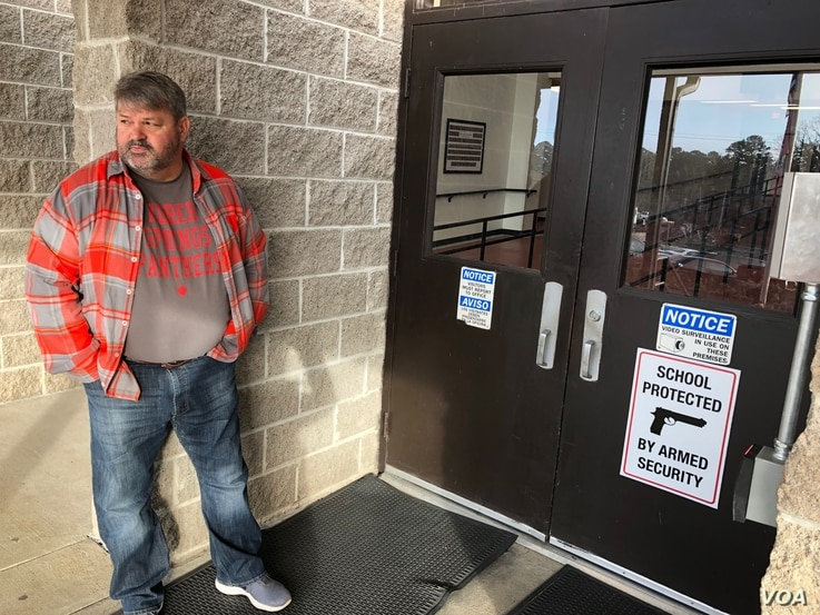 Many Arkansan schools have begun arming faculty in hopes of preventing a future school shooting. Coach Dale Cresswell stands outside a Heber Springs, Ark., school, Dec. 11, 2018 (T.Krug/VOA News)