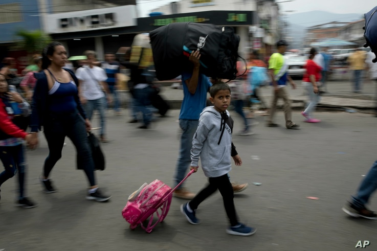Venezuelans leave their country as they make their way to the Simon Bolivar international bridge in San Antonio del Tachira, Venezuela, on the border with Colombia, Feb. 21, 2019.