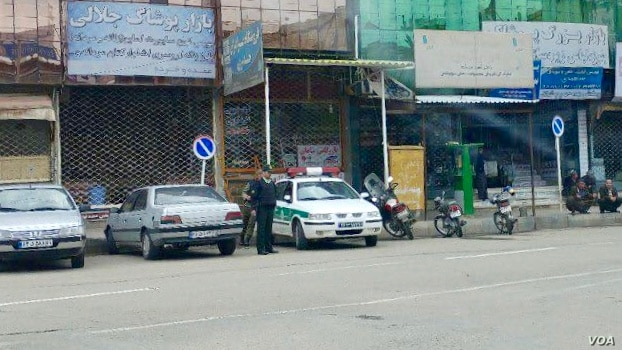 Iranian special police forces patrol the empty streets of Baneh, May 4, 2018, as residents continue a general strike they began on April 15 to protest Tehran's blockade of border footpaths they rely on to import goods to sell.