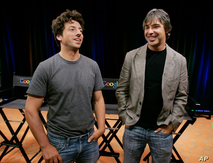 FILE - In this Sept. 2, 2008, photo, Google co-founders Sergey Brin, left, and Larry Page talk during a new conference at Google Inc. headquarters in Mountain View, California. Like many startups, Google reportedly started in a garage.