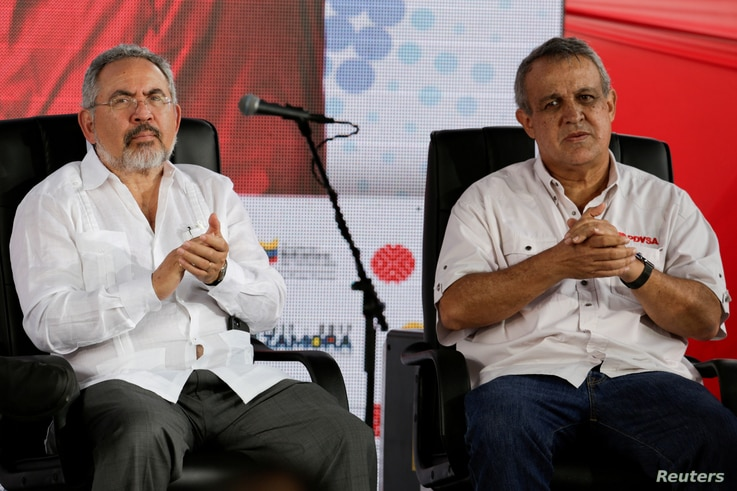 FILE - Venezuela's then-Oil Minister Nelson Martinez (L) and Eulogio del Pino, president of Venezuelan state oil company PDVSA, are seen at a swearing-in ceremony of the new board of directors of PDVSA in Caracas, Venezuela, Jan. 31, 2017.