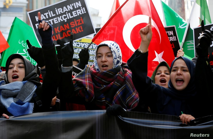FILE - Demonstrators shout slogans during a protest against Iran's role in Aleppo, Syria, near the Iranian Consulate in Istanbul, Turkey, Dec. 16, 2016.