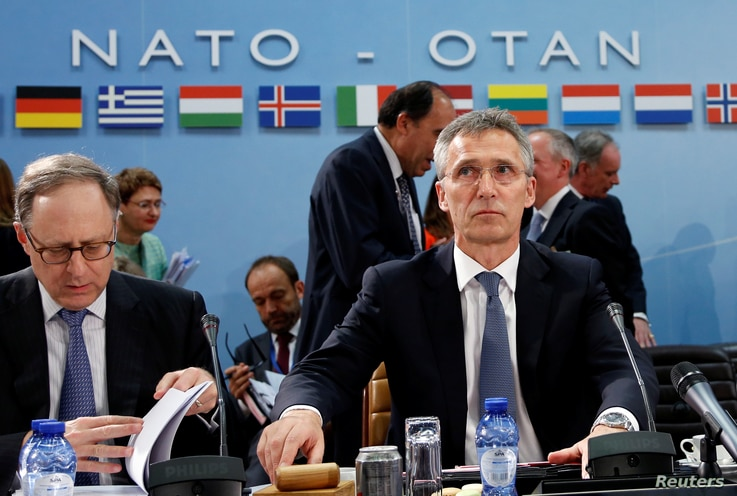 FILE - NATO Secretary-General Jens Stoltenberg chairs a NATO defense ministers meeting at the Alliance headquarters in Brussels, Belgium, June 14, 2016.