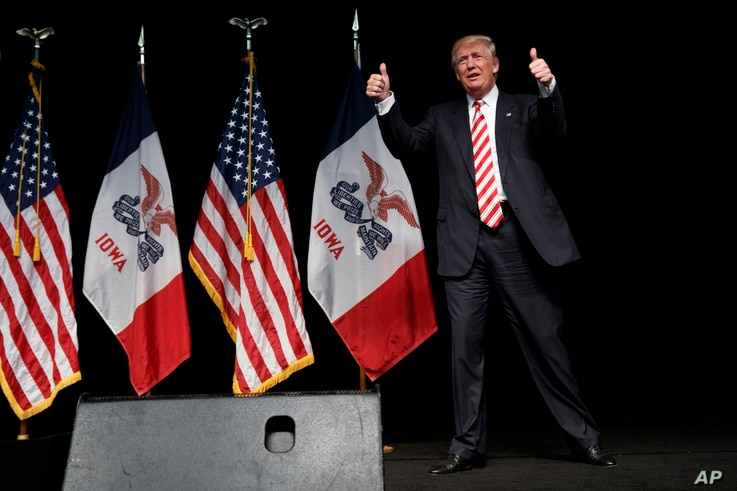 Republican presidential candidate Donald Trump gives thumbs-up as he arrives to speak at a campaign a rally in Clive, Iowa, Sept. 13, 2016.
