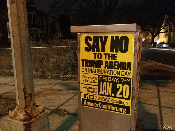 The ANSWER coalition has put up posters across DC calling for people to join their protest against Donald Trump on inauguration day (E. Sarai/VOA News)