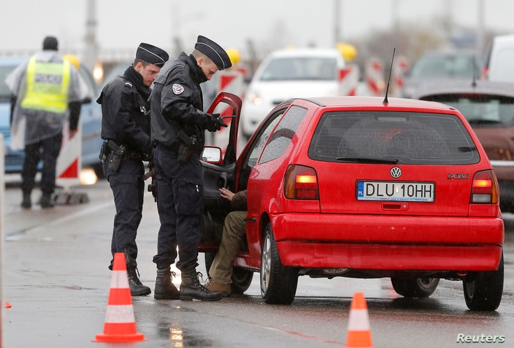 French police conduct a control at the French-German border in Strasbourg, France, to check vehicles and verify the identity of travelers as security increases after last Friday's deadly attacks in Paris, Nov. 20, 2015.