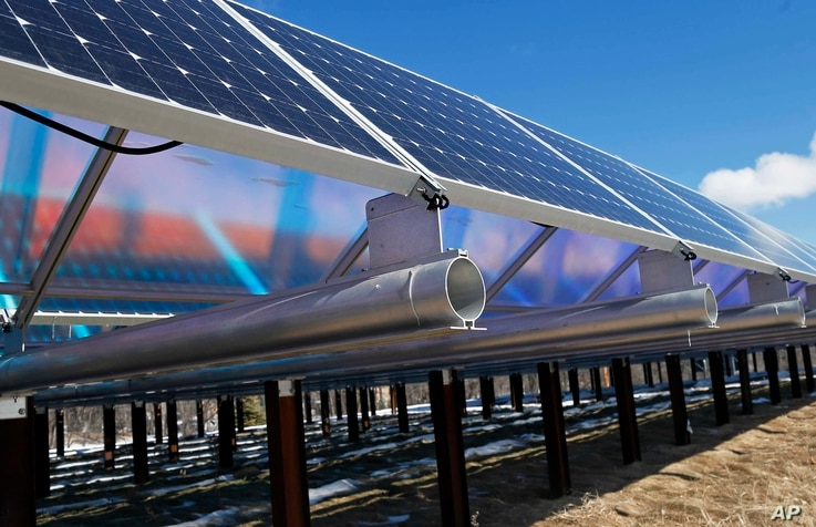solar panels that are part of the Wright-Hennepin Cooperative Electric Association's community gardens are shown in Rockford, Minn., Feb. 26, 2015. Community solar gardens are a new concept in renewable energy, allowing customers who cannot put up so