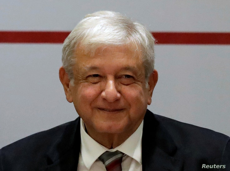 FILE - Mexico's President-elect Andres Manuel Lopez Obrador attends a meeting with elected Mexican senators at a hotel in Mexico City, Mexico, Aug. 15, 2018.