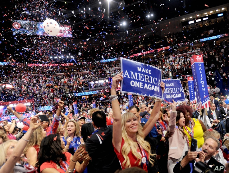 FILE -Delegates cheer then-Republican candedate Donald Trump on the fourth day of the Republican National Convention in Cleveland, Ohio, Aug. 7, 2016