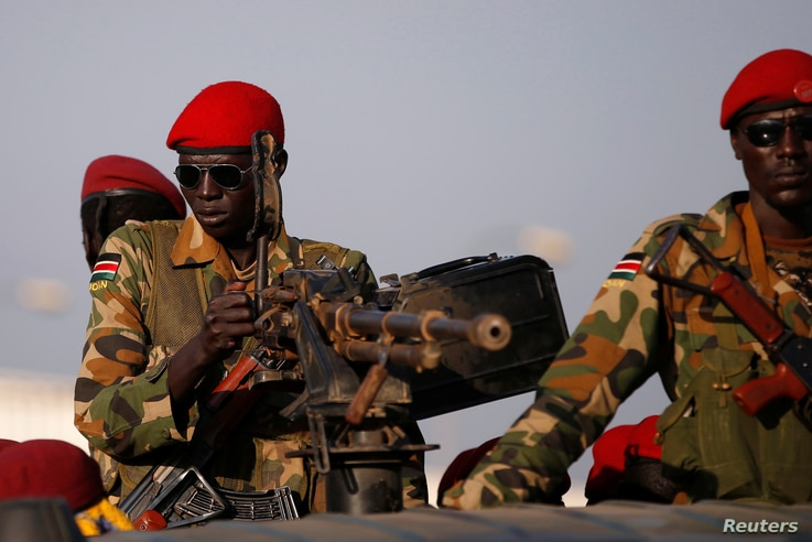 FILE- SPLA soldiers stand in a vehicle in Juba, South Sudan, Dec. 20, 2013.